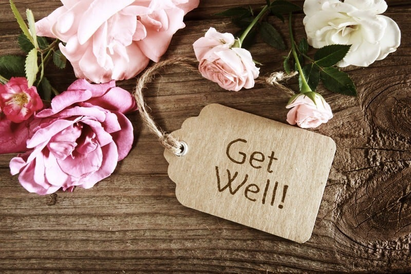 """Tag that says """"Get well"""" on wood with roses"""