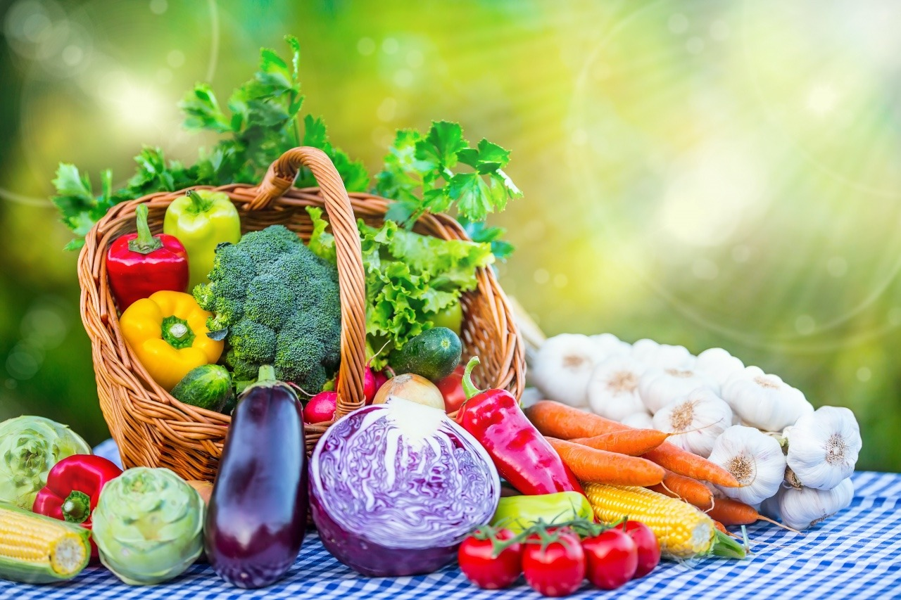 basket overflowing with colorful vegetables and fruits